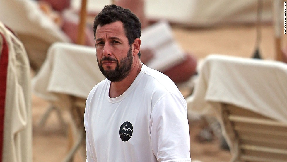Adam Sandler spends the day on the beach in Maui, Hawaii on December 30.