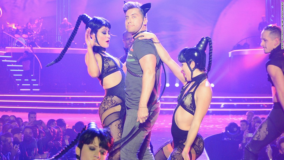 "Lance Bass is pulled on stage by Britney Spears's dancers during her show ""Britney: Piece of Me"" at Planet Hollywood Resort & Casino in Las Vegas on December 30."