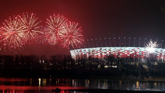 Fireworks welcome the new year over the National Stadium and the Vistula River in Warsaw, Poland.