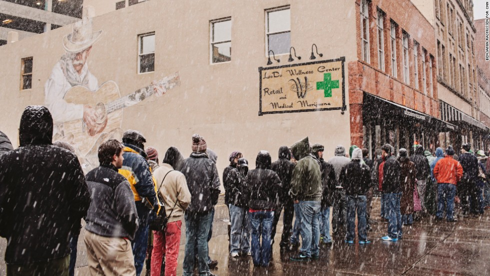 People line up to buy recreational marijuana at the LoDo Wellness Center.