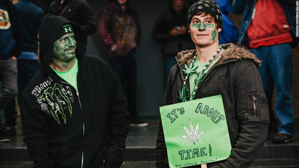 Darren Austin, left, and his son Tyler line up outside the 3D Cannabis Center.