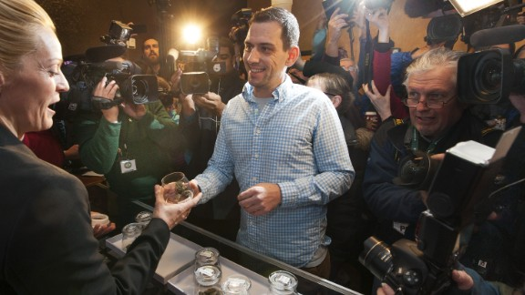 "Sean Azzariti, an Iraq war veteran and marijuana activist, becomes the first person to legally purchase recreational marijuana in Colorado on January 1, 2014. Colorado was the first state in the nation to allow retail pot shops. ""It"