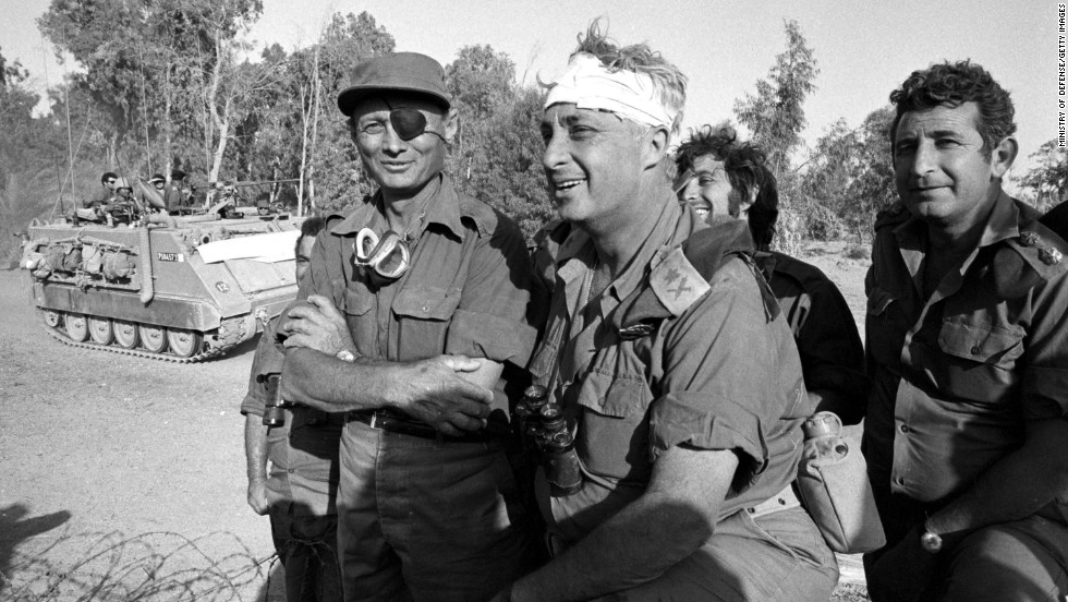 Defense Minister Moshe Dayan (left) visits with a bandaged Sharon during the Yom Kippur War in October 1973 on the western bank of the Suez Canal in Egypt. Sharon said  his greatest military success came during that war. He surrounded Egypt's Third Army and, defying orders, led 200 tanks and 5,000 men over the Suez Canal, a turning point.