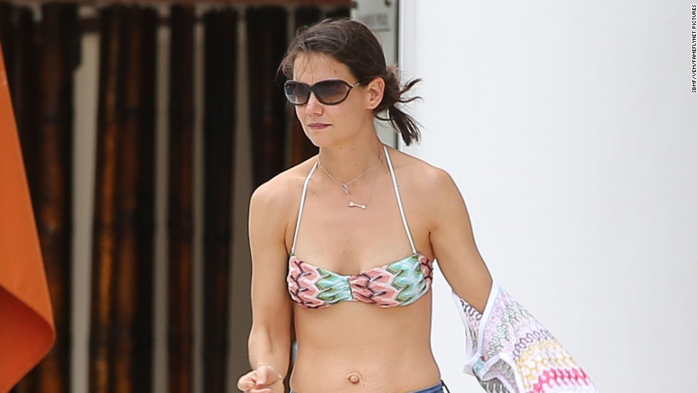 Katie Holmes relaxes poolside on January 1 in Miami, Florida.