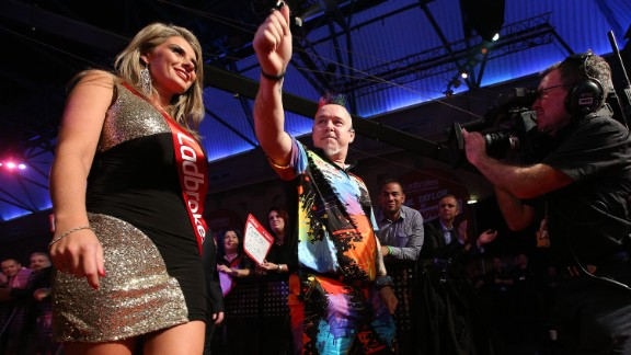 Darts players enter the arena to a chorus of noise with their own signature tune playing over the PA system. Accompanied by darts-style cheerleaders, they play to the crowd before making their way up to the Oche -- the line from where they throw the darts from.