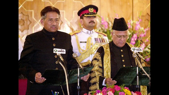 Musharraf, left, takes the presidential oath of office in Islamabad, Pakistan, on June 20, 2001. Musharraf appointed himself president after leading a successful coup against Prime Minister Nawaz Sharif in 1999. He would also remain head of the army.