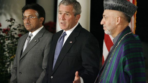 Musharraf, then-U.S. President George W. Bush and Afghanistan President Hamid Karzai stand in the Rose Garden of the White House as Bush delivers remarks in 2006.