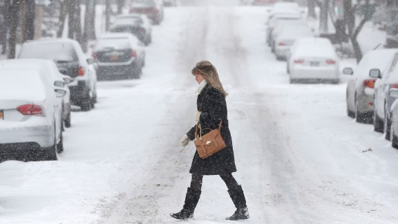 A woman walks through snowy conditions in Albany on January 2.