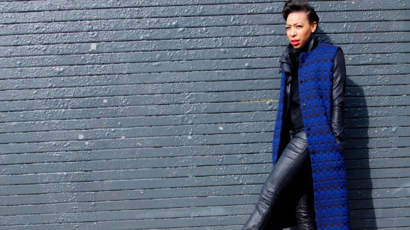 A bright blue waistcoat contrasts with an all-black outfit.