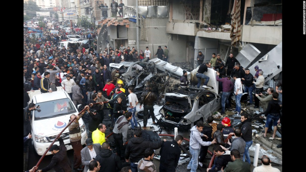 People search for victims at the scene of the bombing.