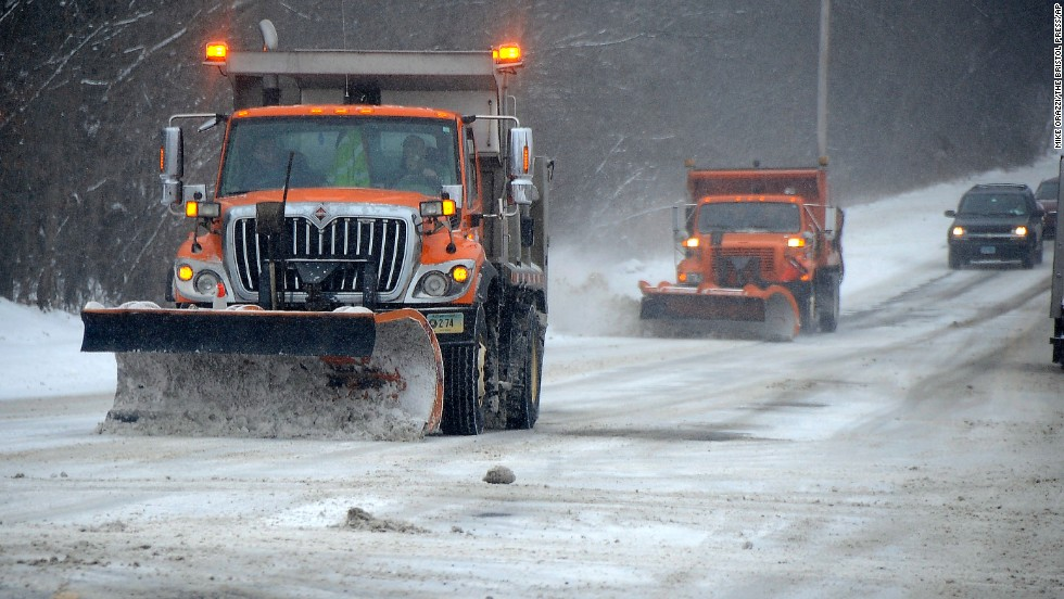 Trucks clear snow off the roads in Torrington, Connecticut, on January 2.