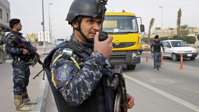 Iraqi federal policemen stand guard at a checkpoint in Iraq on January 2.