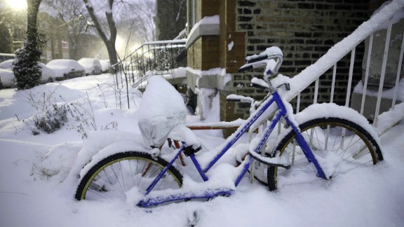 Snow covers bikes along Leavitt Street in Chicago