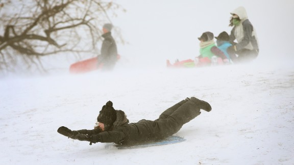 A child sleds down a hill in Chicago