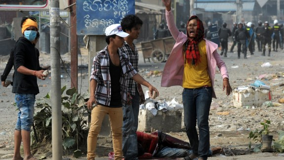 A woman calls for help after a protester was wounded in violence in Phnom Penh on January 3.