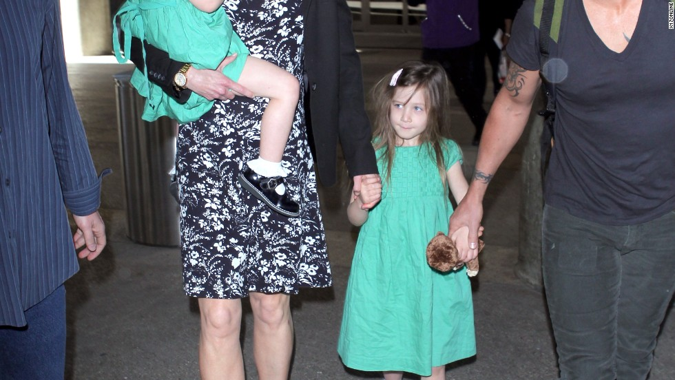 Nicole Kidman travels with husband Keith Urban and their two daughters on January 3.