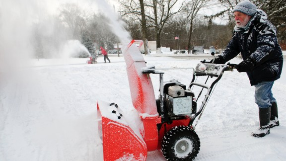 A man uses his snowblower to clear some paths in Mansfield, Connecticut, on January 3.