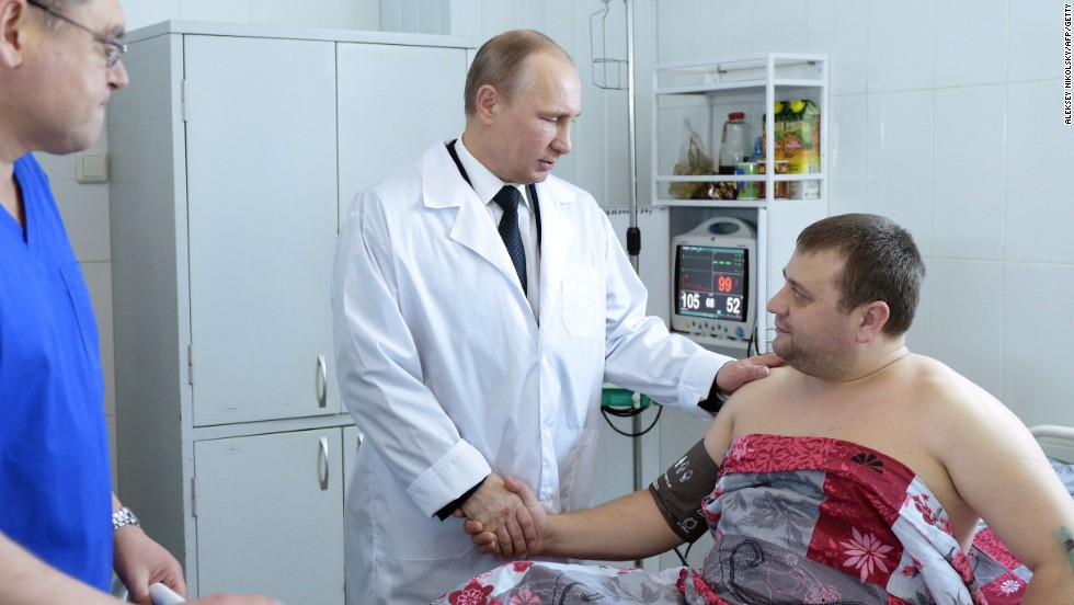 Putin visits a hospital in Volgograd on New Year's Day to visit survivors of two explosions in the city which have called into question security at the 2014 Winter Games.