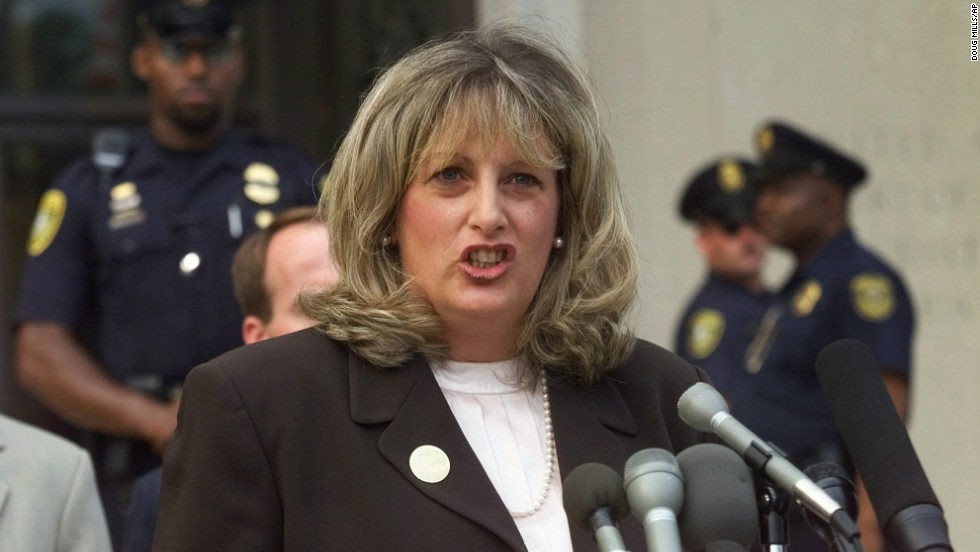 Linda Tripp, the Pentagon employee whose secret tape recordings of Lewinsky triggered the criminal investigation, speaks to reporters in Washington following her grand jury appearance on July 29, 1998.