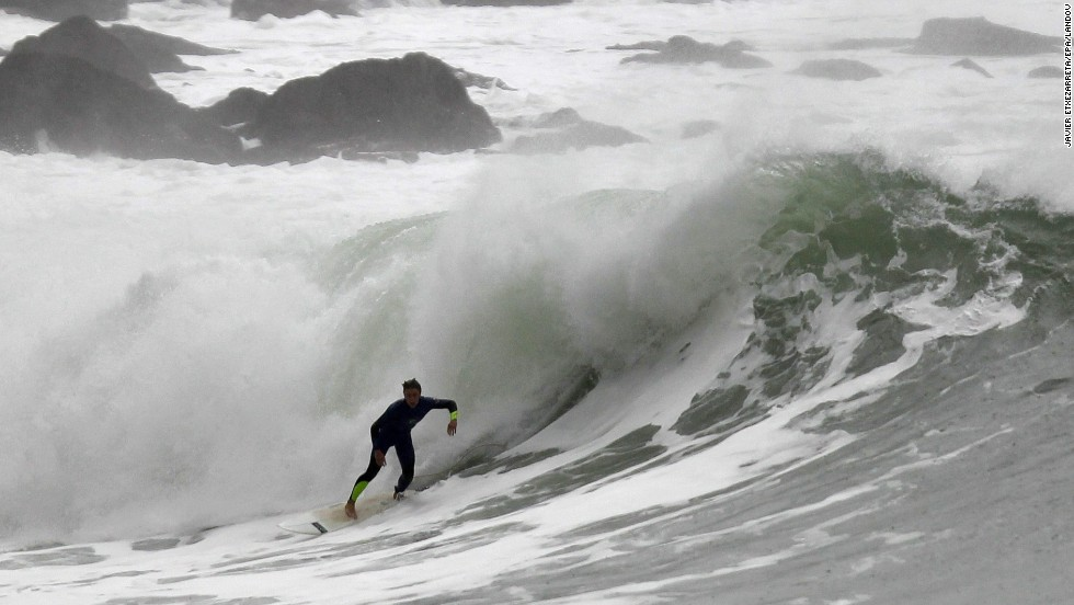 A surfer takes advantage of waves generated by strong winds in Zumaia in northern Spain on January 4.