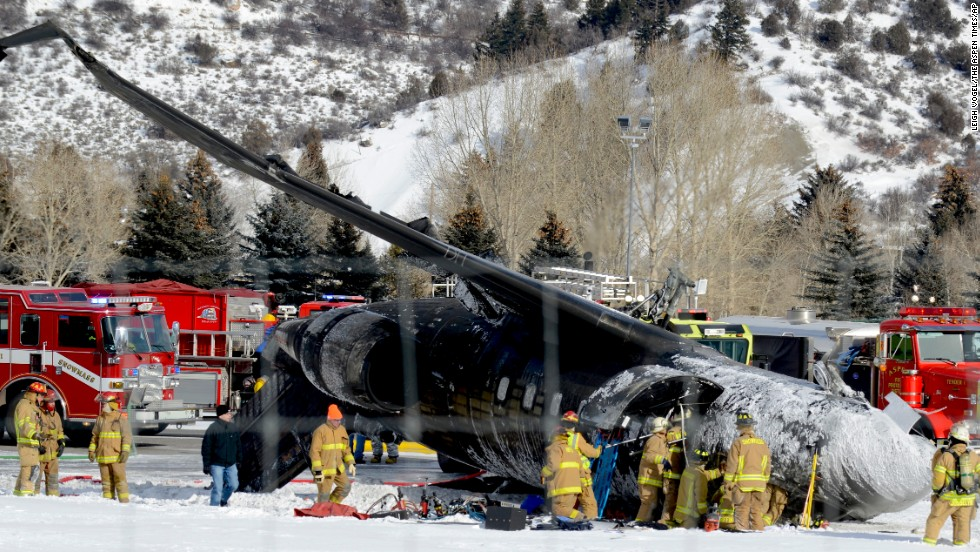 Emergency crews respond to the scene of a small plane that crashed upon landing at the Aspen-Pitkin County Airport in Aspen, Colorado, on Sunday, January 5.