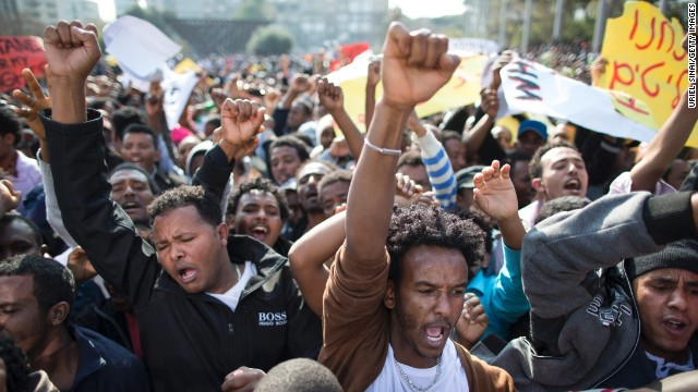 Tens of thousands of African migrants take part in a rally on January 5 in Tel Aviv, Israel.