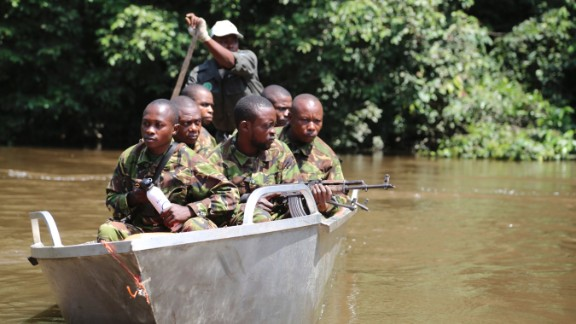 Many of the guards trying to prevent poaching in the Republic of Congo used to be the ones hunting the elephants. The unit's successes haven't made them any friends. Here some of them are pictured on patrol with Odzala-Kokoua National Park's Eco Guards.
