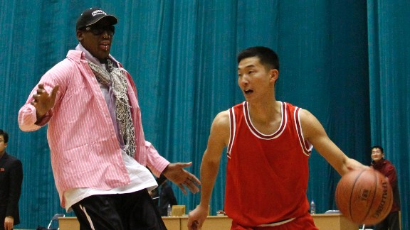 Former basketball star Dennis Rodman plays one-on-one with a North Korean player during a practice session in Pyongyang, North Korea, on December 20, 2013. Rodman and several other former NBA players have arrived in North Korea to take part in a basketball game on Wednesday, January 8, the birthday of North Korean leader Kim Jong Un.