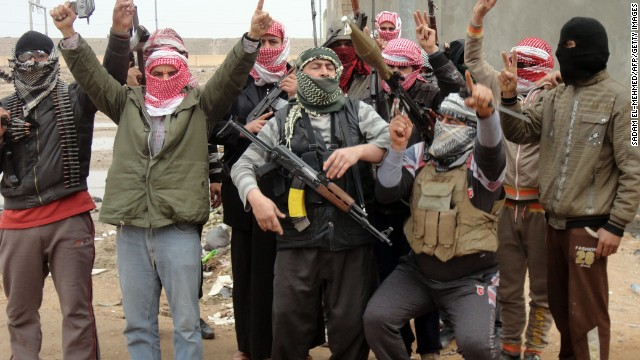 Iraqi men from local tribes brandish their weapons as they pose for a photograph in the city of Fallujah, west of the capital Baghdad, on January 5, 2014.