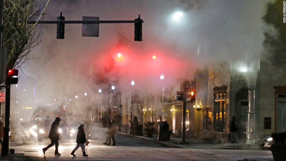 With temperatures nearing 0 degrees, a cloud of steam from a manhole blows across an intersection in downtown Pittsburgh on January 6.