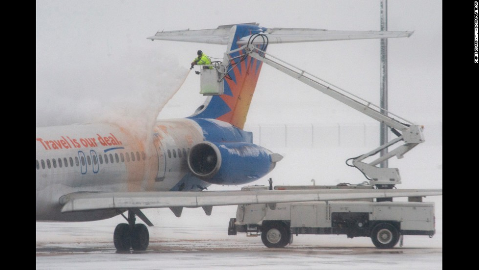 A jet is de-iced at Gerald R. Ford International Airport in Grand Rapids, Michigan, on January 6.