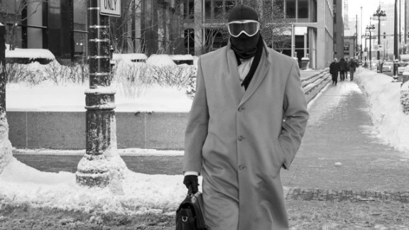 A Chicago man heads to work on January 6 with an overcoat and briefcase ... plus a balaclava and ski goggles.