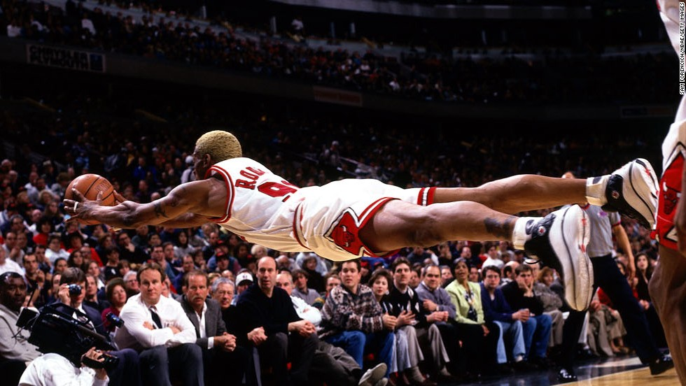Rodman dives for a loose ball during a game in 1997. Rodman is one of the NBA's all-time greatest rebounders, leading the league in that category from 1992 to 1998.