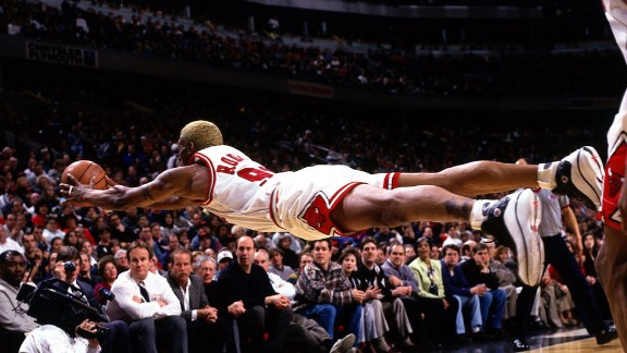 Rodman dives for a loose ball during a game in 1997. Rodman is one of the NBA