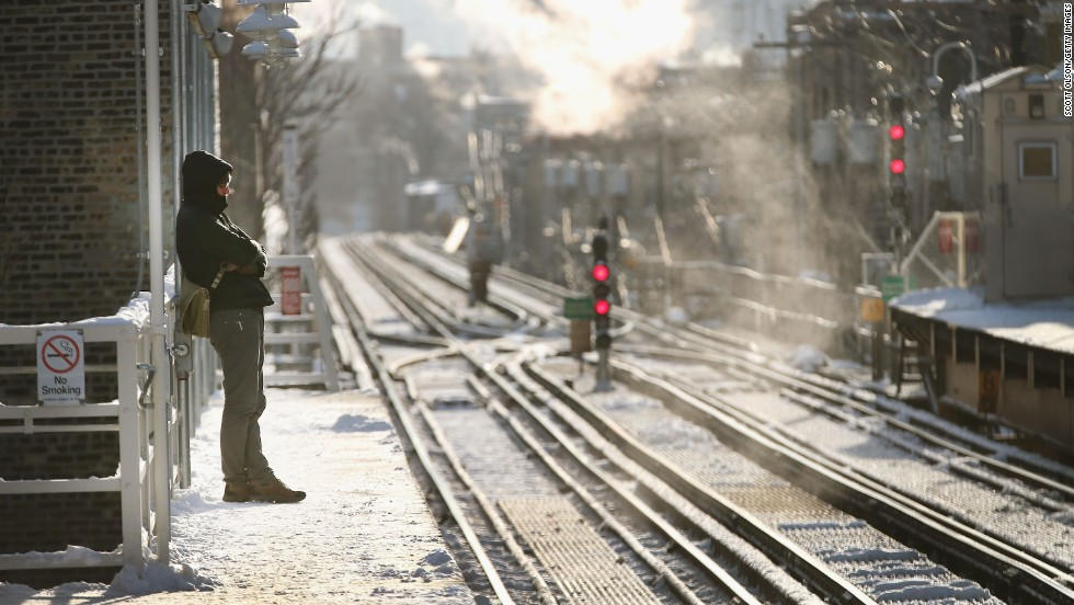 A passenger waits for a train to arrive in Chicago on January 7, when temperatures were below zero.