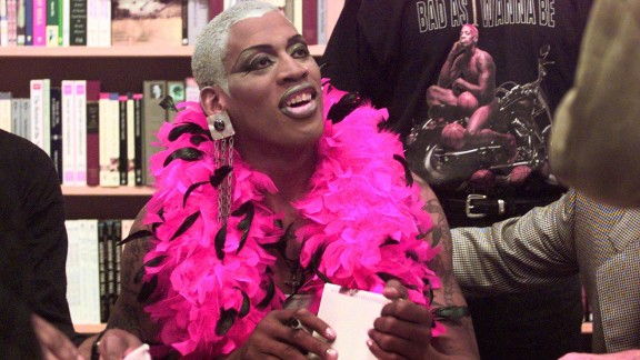 """Rodman signs his first autobiography, """"Bad As I Wanna Be,"""" in a Chicago bookstore in 1996."""