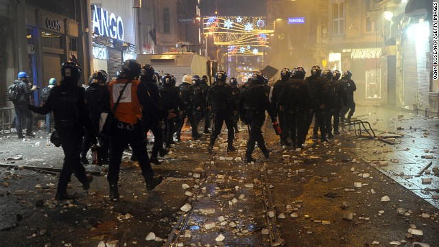 Turkish riot police patrol Istiklal Avenue in Istanbul amid clashes with protesters on December 27.