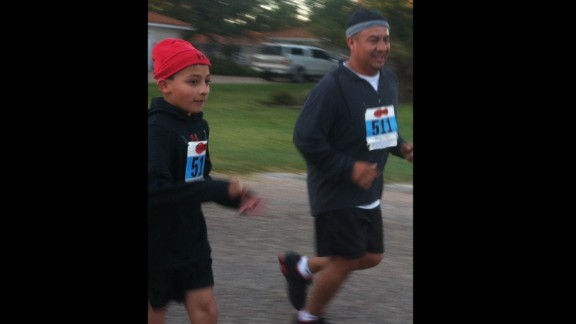 """Michael Joe Frausto Jr., a single father in Knox City, Texas, took up running as a way to spend time with his two kids, including his 10-year-old son, Michael Joe Frausto III, who did a 5K race with his dad. """"I've always instilled in both children (that) with effort, so much more in life can be accomplished,"""" he said."""