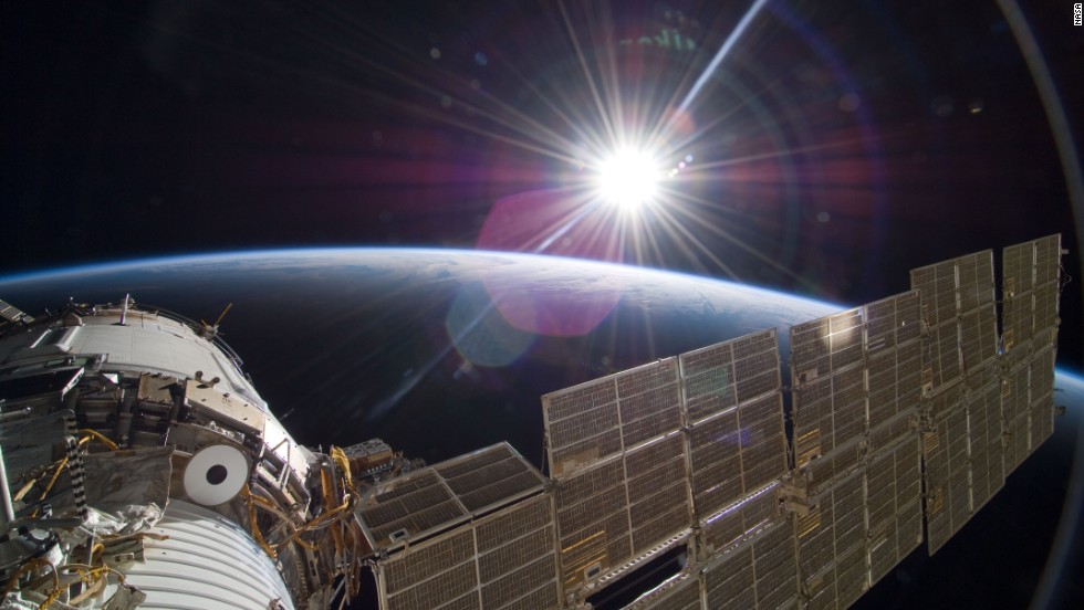 The bright sun greets the International Space Station from the Russian section of the orbital outpost, photographed by one of the STS-129 crew members.
