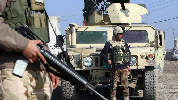 """Iraqi soldiers monitor a checkpoint east of Baghdad on January 6, 2014, the 93rd anniversay of the Iraqi Army, as Iraq is preparing a major attack to retake Fallujah, 74 kilometres west of the capital which has been outside government control for days, while parts of Anbar provincial capital Ramadi, farther west, are also held by Al-Qaeda-linked fighters. Iraqi Prime Minister Nuri al-Maliki called for Fallujah residents to expel """"terrorists"""" holding the city to avoid an assault by security forces, as they battled gunmen in nearby Ramadi. AFP PHOTO / ALI AL-SAADIALI AL-SAADI/AFP/Getty Images"""