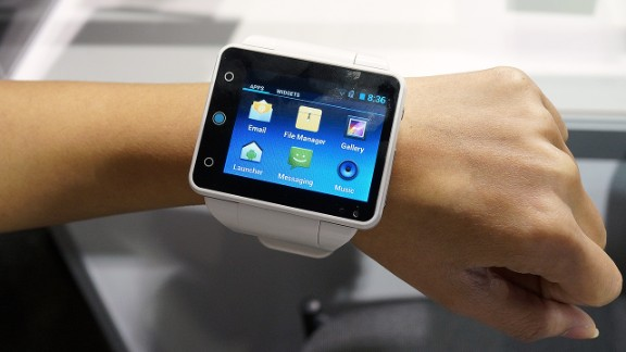"""Big watch or tiny phone? The bulky 2.4-inch touchscreen <a href=""""http://www.neptunepine.com/"""" target=""""_blank"""" target=""""_blank"""">Neptune Pine</a> smart watch runs Android Jelly Bean and is a fully functioning phone. It will cost $335 to $395 when it's released in March."""