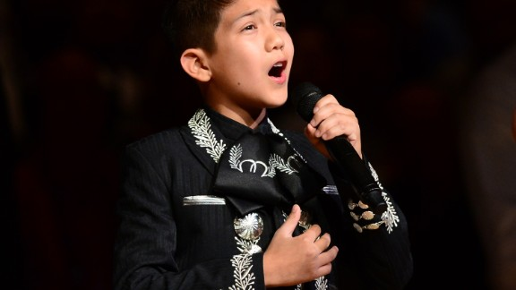 """Sebastien De La Cruz, known as San Antonio's Little Mariachi, sang the national anthem before an NBA finals game between the San Antonio Spurs and the Miami Heat in 2013. When <a href=""""http://www.cnn.com/2013/06/12/us/mexican-american-boy-sings-anthem/"""">some questioned his citizenship</a> and mariachi outfit, it sparked defense of the young singer from notables such as actress <a href=""""http://www.cnn.com/2013/06/14/us/mexican-american-boy-encore/"""">Eva Longoria</a>."""