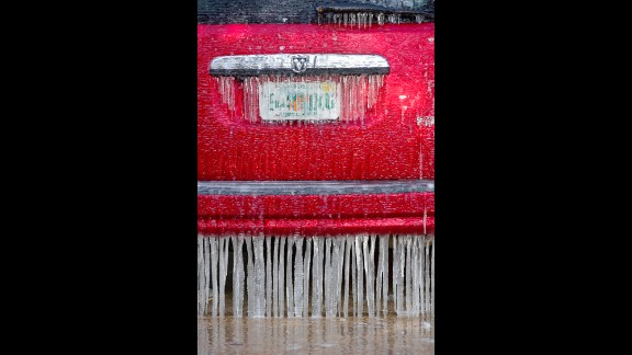 Icicles hang from the bumper of a vehicle in Fort Walton Beach, Florida, on Tuesday, January 7.