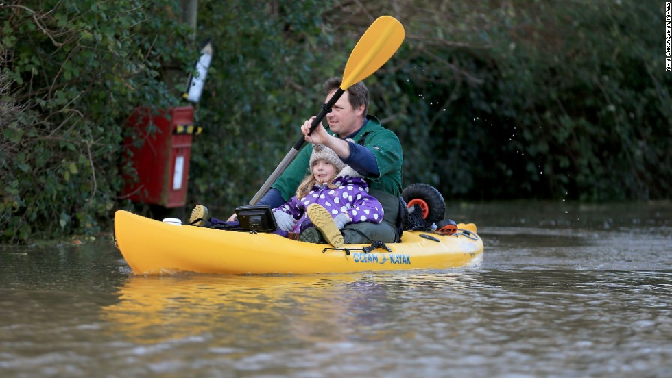 Extreme sports aren't for everyone.  A resident in Somerset, England opts for a serene ride in a canoe to escape the floodwaters.