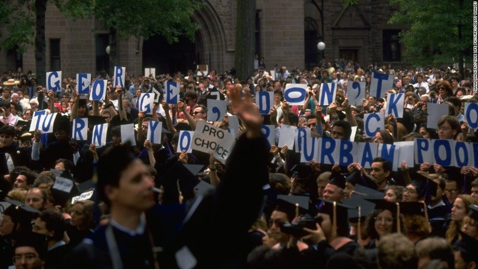 "During a 1991 commencement speech given by President George H. W. Bush at Yale University, attendees hold signs that read, ""George, don't turn your back on urban poor."" Like Carter, Bush was more concerned with other issues during his presidency."