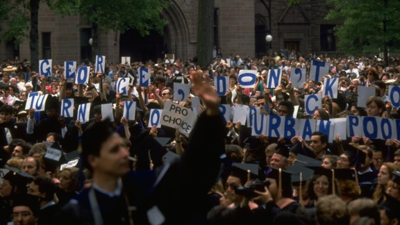"During a 1991 commencement speech given by President George H. W. Bush at Yale University, attendees hold signs that read, ""George, don"
