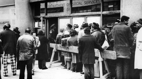 Unemployed Americans stand in line at a New York welfare office in 1974. Economic crises gripped the country in the early