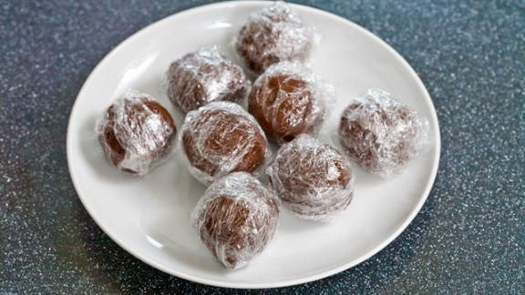 """This recipe makes 10 chocolate balls that can be pulled from the freezer and heated with a cup of milk for delicious """"instant"""" hot chocolate. First step: roll, refrigerate, freeze."""