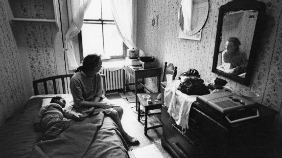 In 1971, a woman and child rest in their room at a New York City hotel for people living on welfare. Johnson