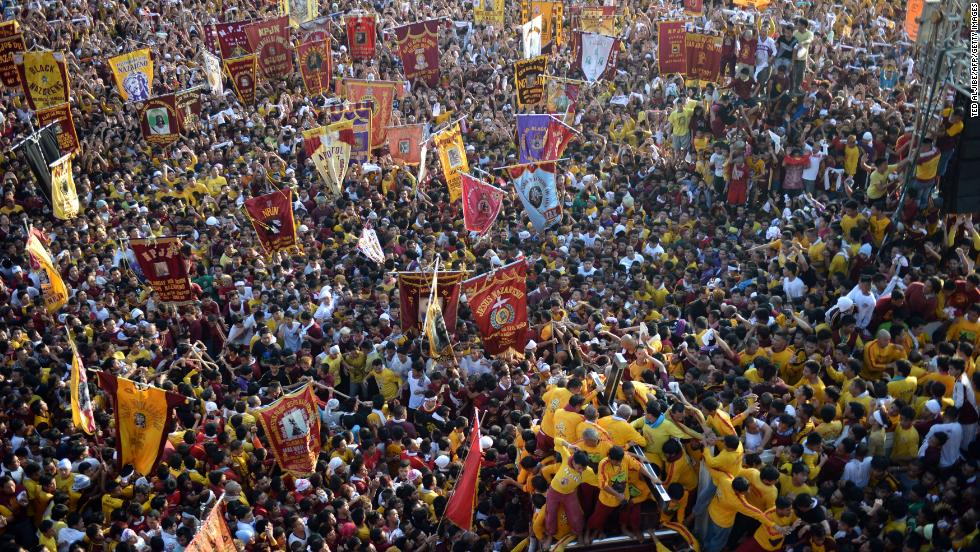 JANUARY 9 - MANILA, PHILIPPINES: Hundreds of thousands of barefoot Catholic devotees attend the annual Black Nazarene parade in Manila. Many climb over one another as the slow-moving procession takes over the streets, trying to touch a life-sized ebony statue of Jesus Christ, known as the Black Nazarene, which they believe has miraculous powers.